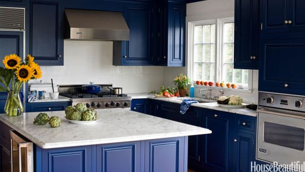 Cobalt blue kitchen with marble countertops via House Beautiful
