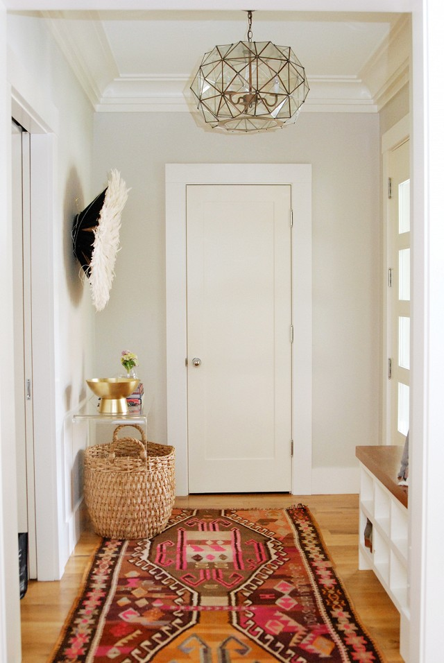 That rug is amazing, and I love the light in this entry hall! I need a shoe cubby bench, too. | 100+ Beautiful Mudrooms and Entryways at Remodelaholic.com