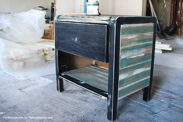Add a lower shelf and use faux stained and painted barn boards to update a boring piece of furniture // Nightstand Makeover by FreshCrush for @Remodelaholic