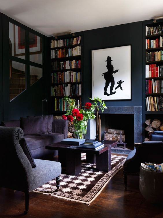 Dark and moody black fireplace with floating shelves