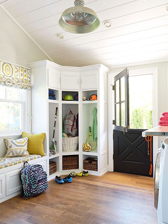 Large white mudroom with a corner storage locker unit and a Dutch door. Adding to my dream house list! | 100+ Beautiful Mudrooms and Entryways at Remodelaholic.com