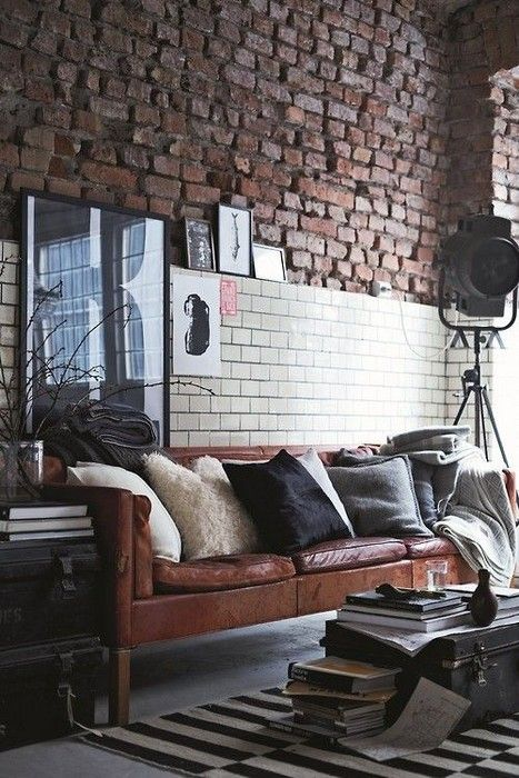 Two styles of brick on the wall, plus a leather sofa