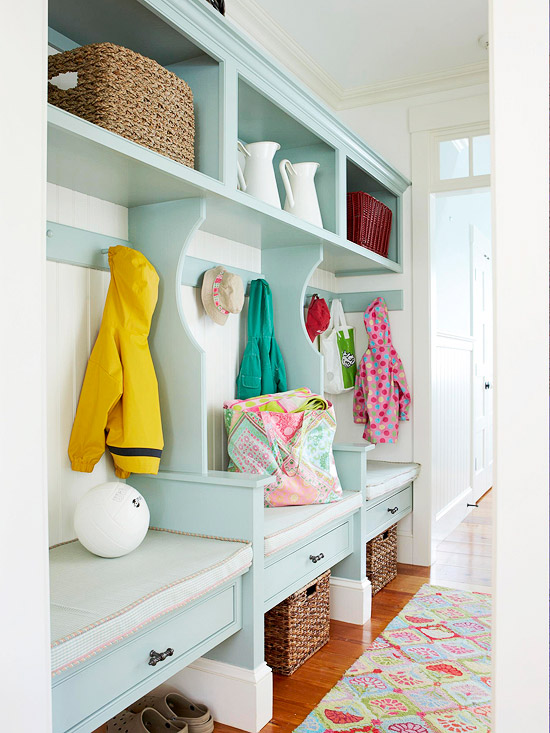 Fun striped cubbies for entryway, love the light turquoise aqua color (and the rug!) | 100+ Beautiful Mudrooms and Entryways at Remodelaholic.com