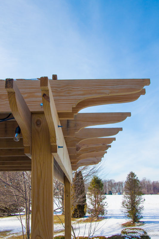 Beautiful DIY pergola! Tutorial on Remodelaholic.com from The Heathered Nest