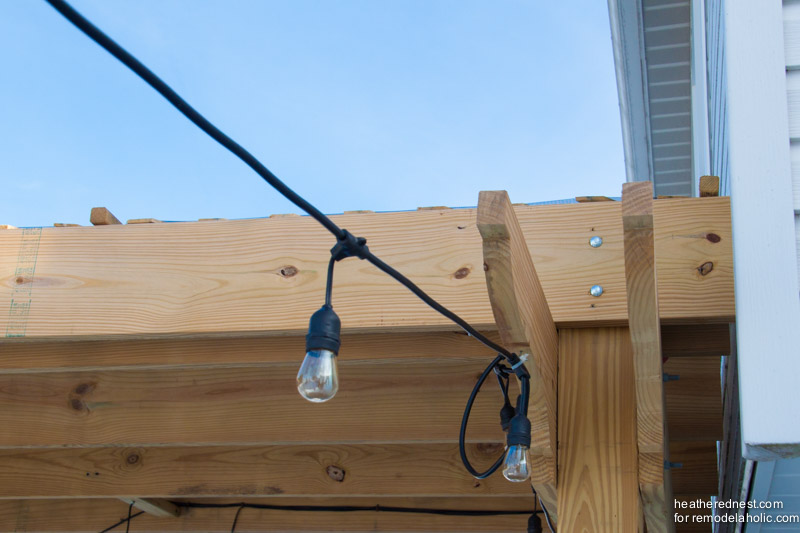 DIY pergola with string lights on a deck, The Heathered Nest for Remodelaholic.com