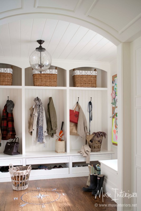 Unique mudroom cabinets, I really like the shape of the locker sections and the sliding shoe storage underneath | 100+ Beautiful Mudrooms and Entryways at Remodelaholic.com