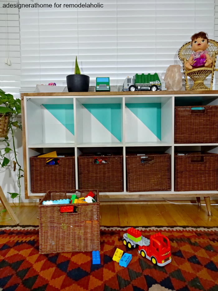 a modified cube organizer made to fit in with other furniture and look better