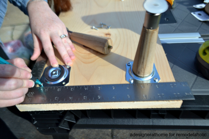 adesigner at home for remodelaholic marking screw holes for furniture leg plates