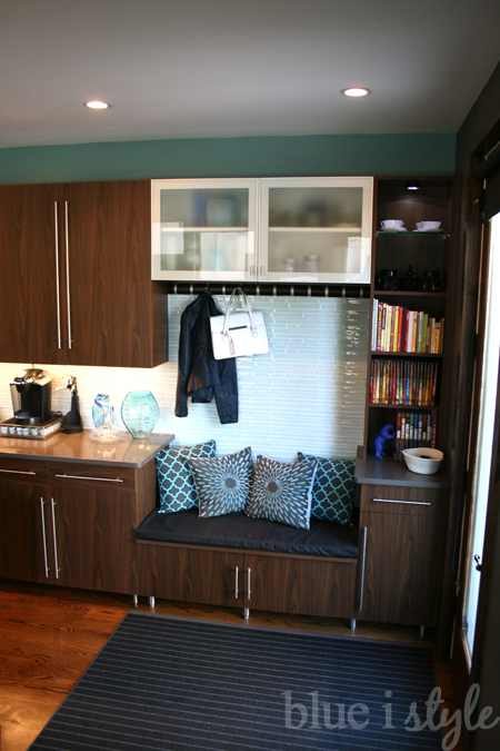 Turn a little corner of the kitchen into a mudroom, complete with a bench. Smart! | 100+ Beautiful Mudrooms and Entryways at Remodelaholic.com
