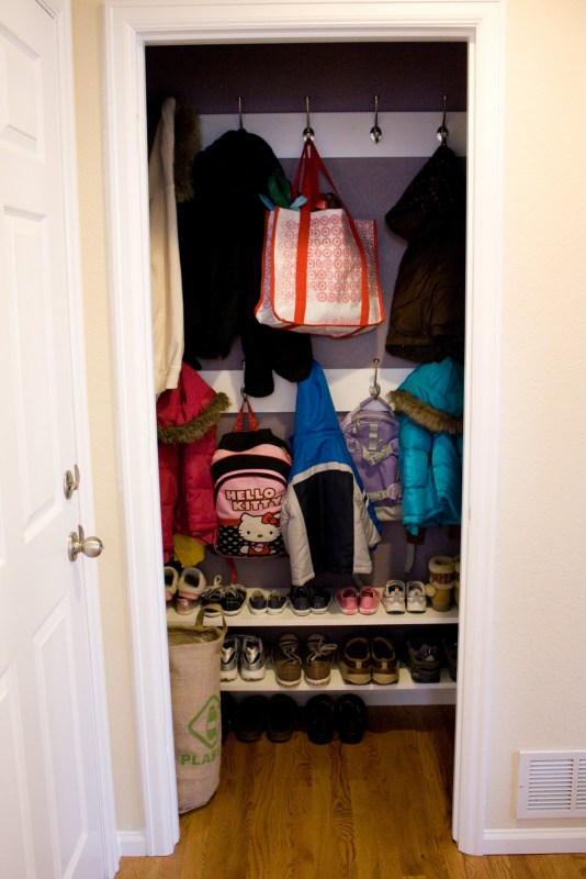 closet hooks and mudroom, narrow shelf for shoes, take off the closet door | 100+ Beautiful Mudrooms and Entryways at Remodelaholic.com