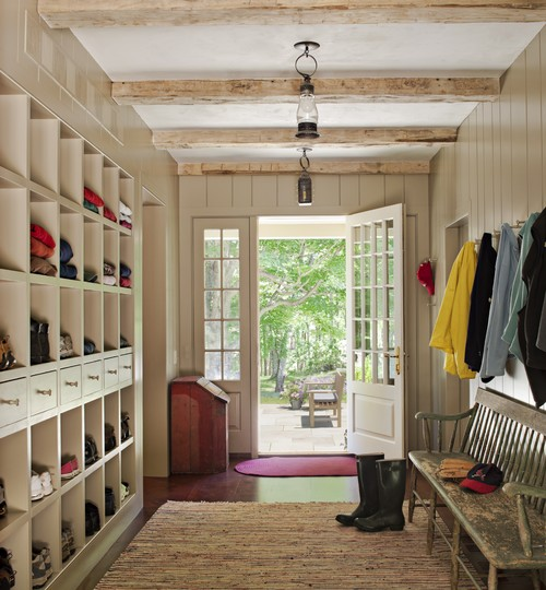 Farmhouse style entry, love the beams and LOOK at all the storage in those cubbies! | 100+ Beautiful Mudrooms and Entryways at Remodelaholic.com