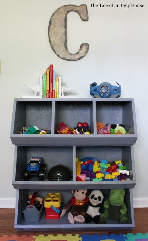Complete tutorial for building a toy organizer out of plywood by Tale of an Ugly House featured on @Remodelaholic