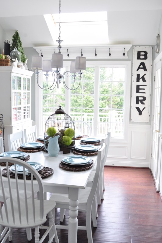 Build an above-window shelf with hooks, perfect for a country cottage farmhouse kitchen! Tutorial on Remodelaholic.com