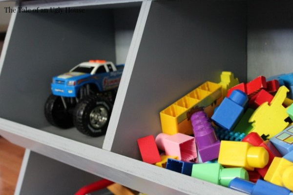 Organize your kids toys with one sheet of plywood! Tutorial for toy cubby by Tale of an Ugly House featured on @Remodelaholic