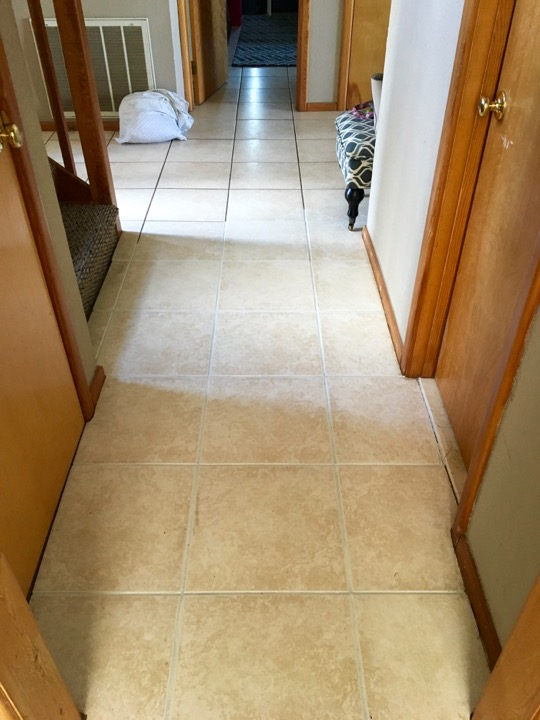 If you're struggling with dated tile, give your floors an easy update! It's simple and inexpensive to dye grout to refresh your older tile floor.