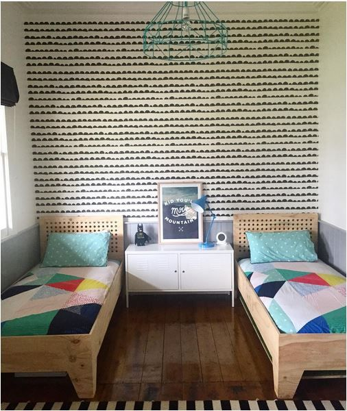 Shared Kids Space Inspiration - love the stamped style wallpaper and geometric quilts