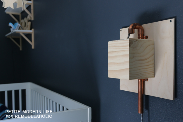 Make this industrial modern, apartment friendly DIY wall sconce with the simplest of materials!