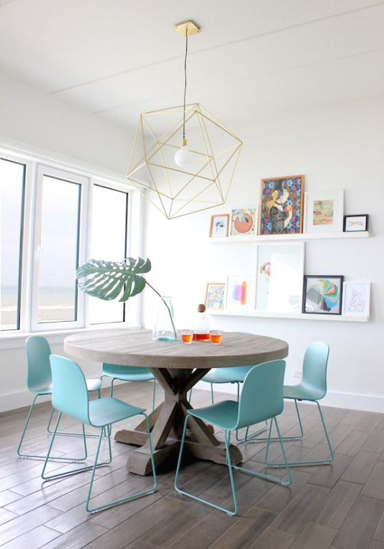 Beautiful dining area | Modern Tropical Style on Remodelaholic.com