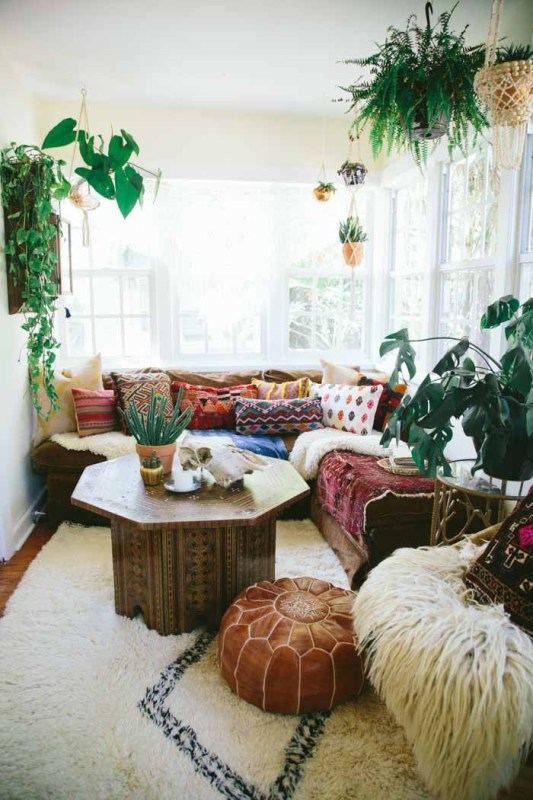 beach style living room with plants   Modern Tropical Style on Remodelaholic.com