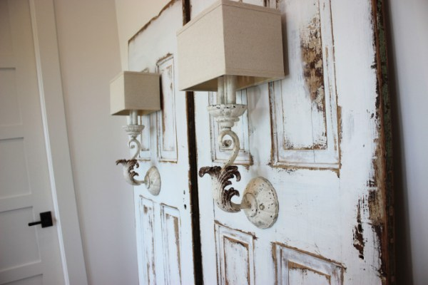 Antique doors refinished to make bedside lamp, by Simple Nature Decor featured on @Remodelaholic