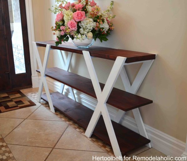 An easy build, DIY Double X farmhouse console table for your entryway. Build for less than $50. Beginner woodworking plan. #remodelaholic