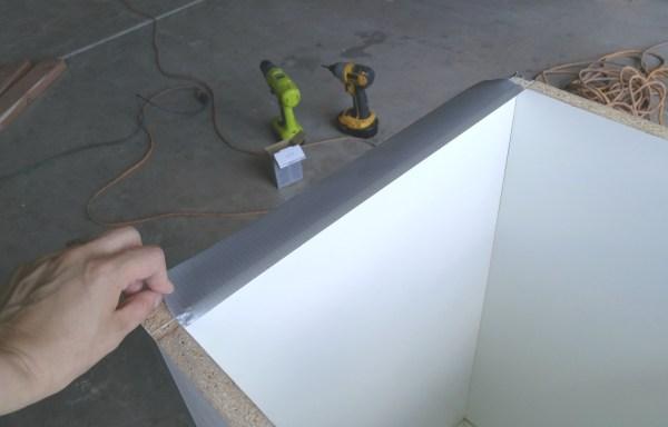 taping-raw-edges-diy-tall-concrete-planter