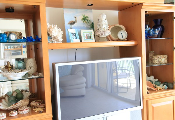 Large entertainment center replaced with DIY Beachy Console Table, by Shabbyfufu featured on @Remodelaholic