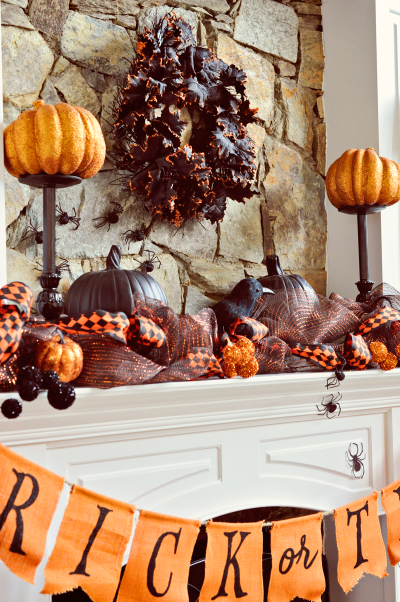 Spray painted lamps turned decor stands for the mantel | Simple Halloween Decor Ideas and Tutorials at Remodelaholic.com