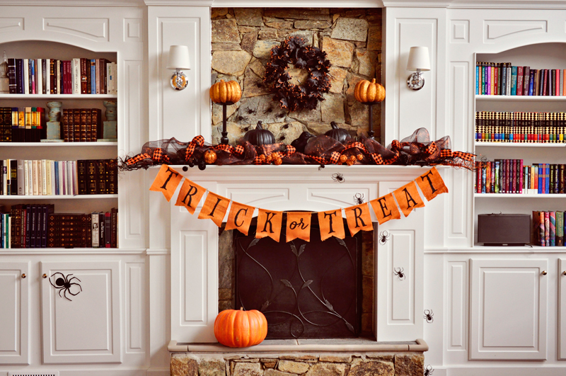 Spray painted lamps turned mantel decor stands | Simple Halloween Decor Ideas and Tutorials at Remodelaholic.com