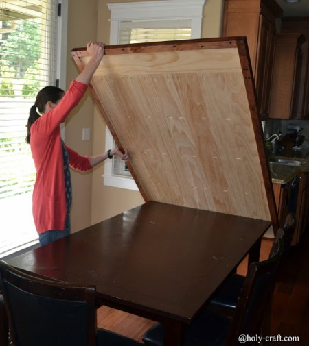 Genius! Removable table top allows mom to craft and not worry about damaging dining table! by Rachel Teodoro at Holy Craft featured on @Remodelaholic
