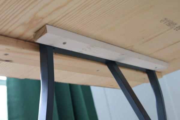 Ikea trestle legs used on DIY live edge table top by Windgate Lane featured on @Remodelaholic