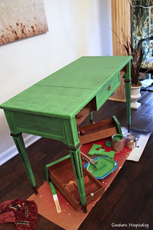 Tutorial for using chalk paint to refinish furniture in an accent color by Southern Hospitality featured on @Remodelaholic