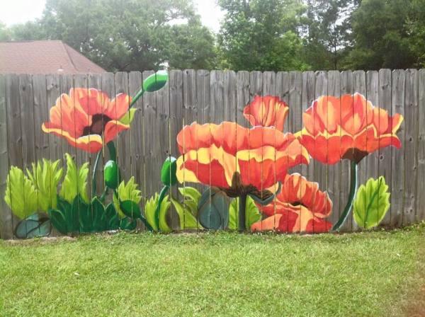 beautiful fence mural by Lori Anselmo Gomez in Pearl River, Louisiana
