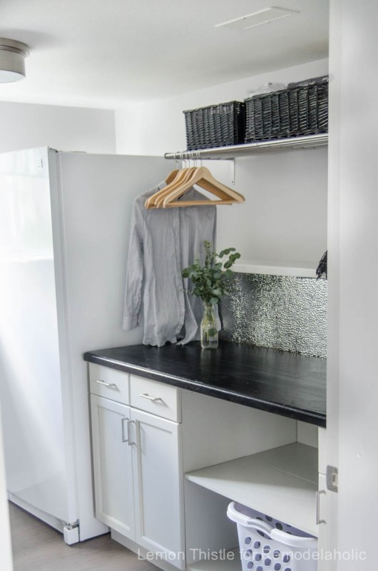 A textured metal ceiling tile backsplash is chic, modern, and durable -- and easy to install with a good pair of gloves and the right adhesive!