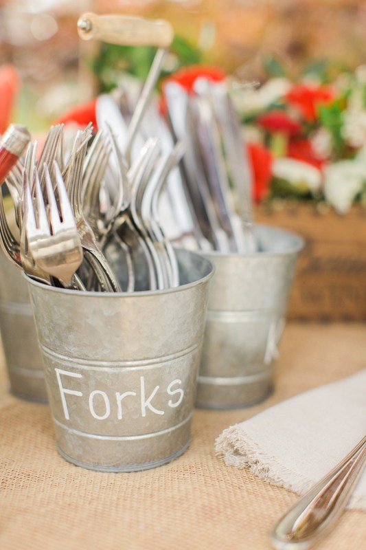 use inexpensive metal buckets to hold utensils for a party or wedding reception via Save On Crafts
