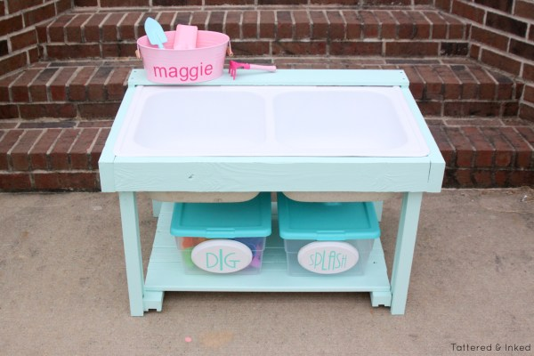 Kids water and sand table from reclaimed kitchen sink by Tattered and Inked featured on @Remodelaholic