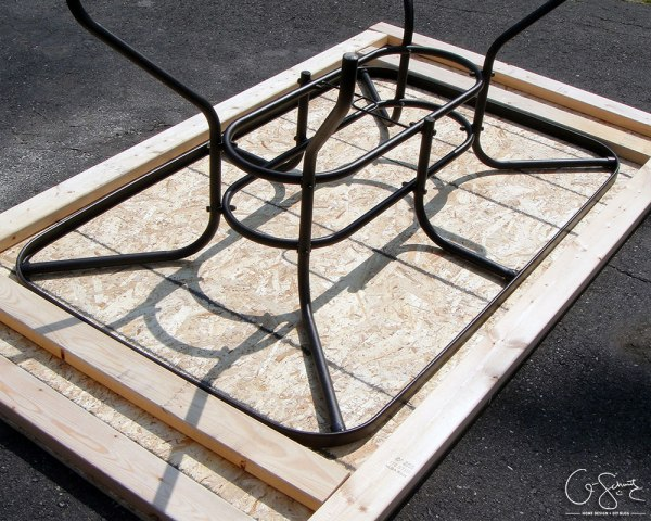 Salvage a patio table by building a new top for it with tile and mosaic tile by Q-Schmitz featured on @Remodelaholic