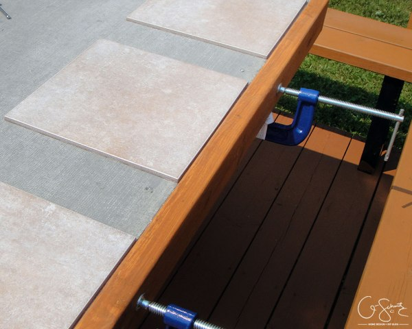DIY tiled table top with beautiful mosaic tile edges by Q-Schmitz featured on @Remodelaholic