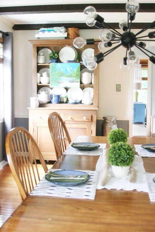 hang an art canvas on the front of a china cabinet shelf for decor, summer decor ideas at Craftivity Designs