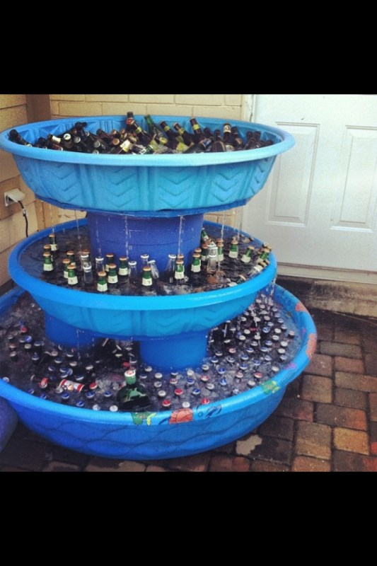 stacked kiddie pools for a drink cooler at a party via @Remodelaholic