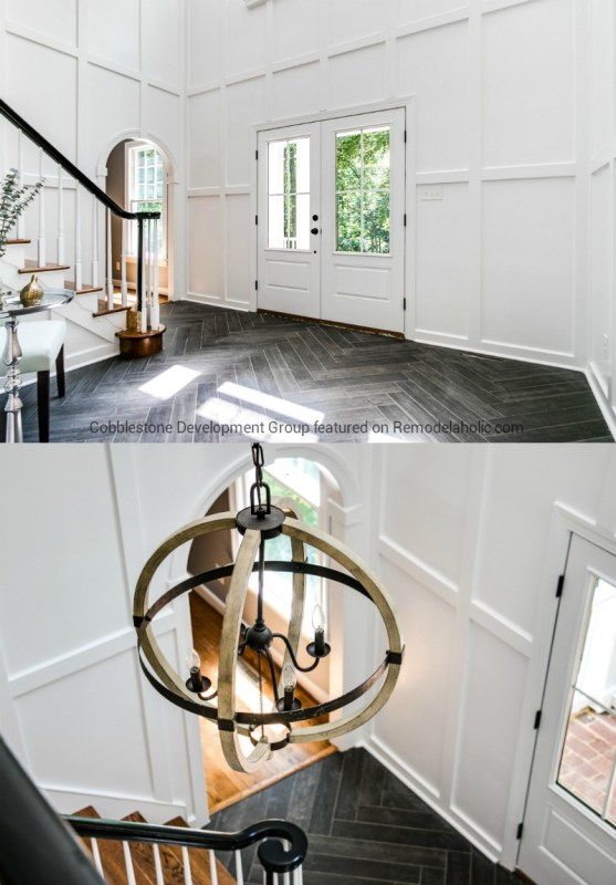 Stunning Entryway Renovation with Tall Board and Batten Walls and Dark Herringone Tile Floors, Fendall Home Renovation, Cobblestone Development Group featured on @Remodelaholic