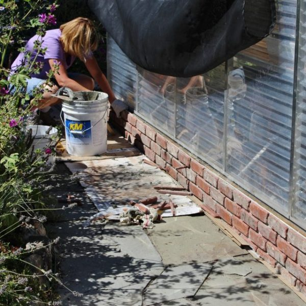 using-thin-bricks-to-cover-up-the-foundation-of-a-greenhouse-my-sweet-cottage