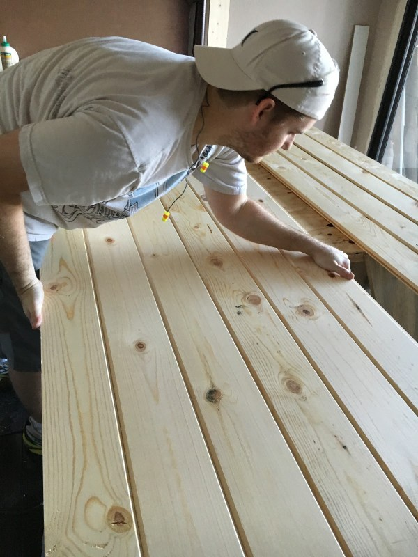build-a-barn-door-the-simplest-way-possible-with-tongue-and-groove-boards-from-home-depot-over-inspired-featured-on-remodelaholic