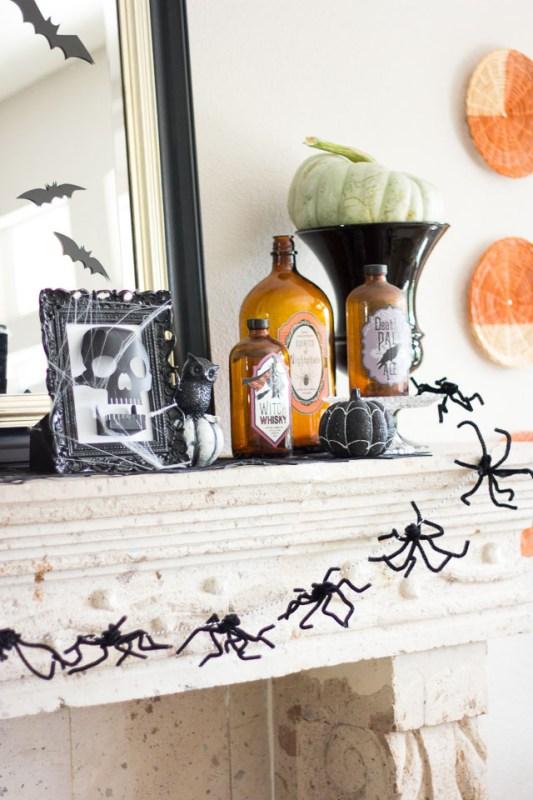 Halloween mantel with spider garland