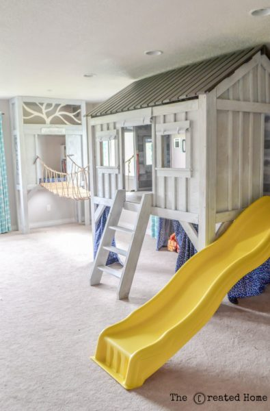 The Created Home Cabin Playroom With Rope Bridge And Climbing Wall