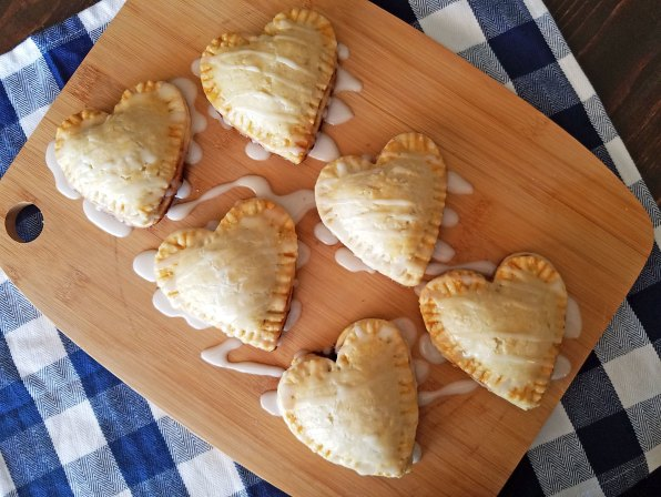 The perfect dessert for Valentine's! Mini Heart Shaped Blackberry Pies Recipe at Remodelaholic.com