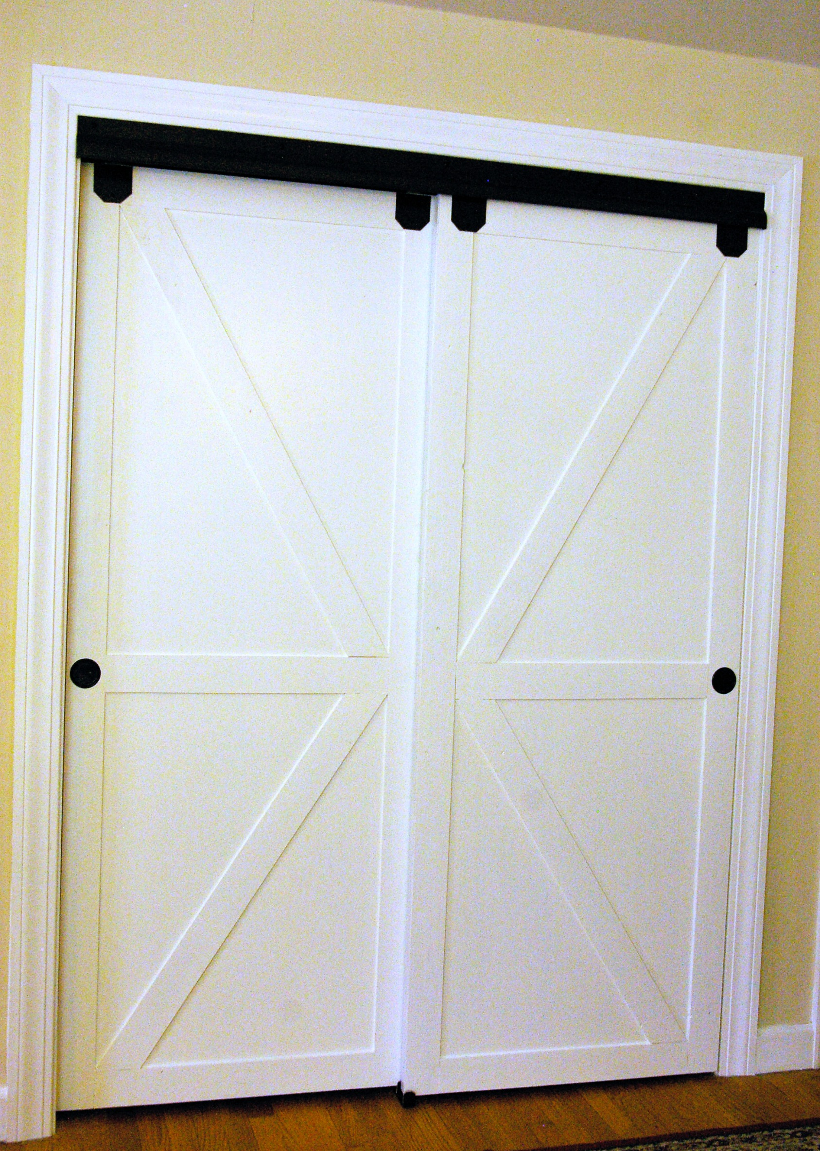 Diy Faux Barn Doors On A Sliding Bypass Closet Door 02 Featured On @Remodelaholic Edit & Remodelaholic | How to Make Bypass Closet Doors Into Sliding Faux ...
