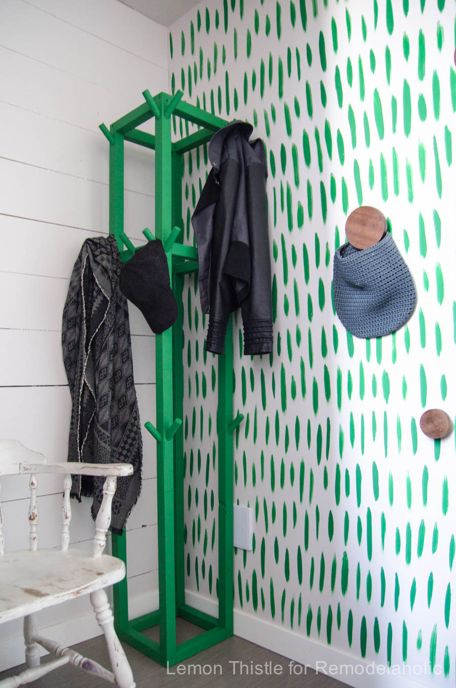 I love this DIY wooden coat rack- the cube shape and green paint is so fun!
