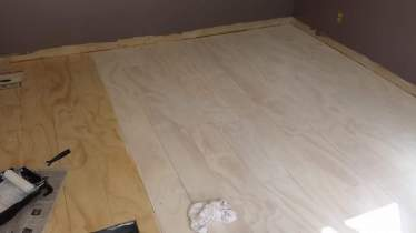 Plywood Plank Flooring, Angela McKinney, 8 Inch Planks Whitewashed, Featured On @Remodelaholic