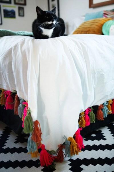 DIY+yarn+tassel+duvet+blanket+|+www.freckleandfair.com